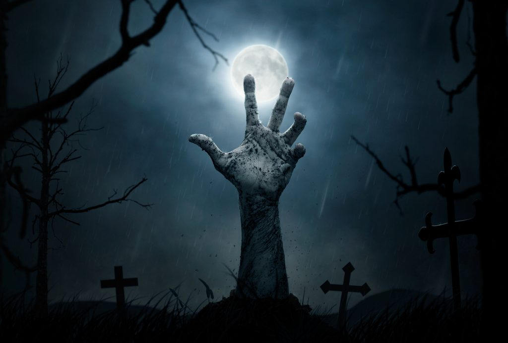 Halloween, dead hand coming out from the soil